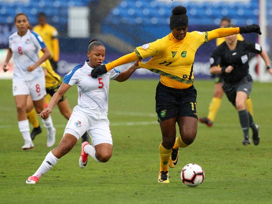 Panama midfielder Katherine Castillo (4) and Jamaica midfielder Khadija Shaw battle for the ball during the first half of the third place match of the CONCACAF women's World Cup qualifying tournament, Wednesday, Oct. 17, 2018, in Frisco, Texas. (AP Photo/Richard W. Rodriguez)