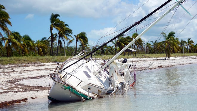 A capsized sailboat boat sits in the water off Key West following the passage of Hurricane Irma.     (Via OlyDrop)