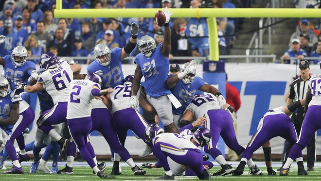 Lions defensive lineman A'Shawn Robinson goes after an extra-point kick by Vikings Kai Forbath during the first quarter on Thursday, Nov. 23, 2017, at Ford Field.