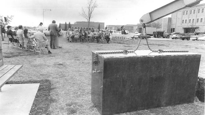 The MSU Ex-Students Association prepares to bury a time capsule in 1983.