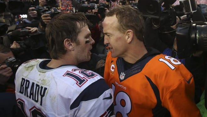 The faces of an NFL generation, Peyton Manning and Tom Brady shake hands after the game.