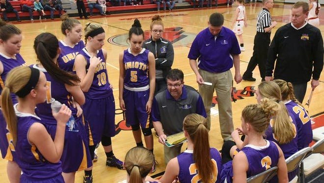 Unioto's Jeff Miller talks with his team during a timeout on Dec. 13, 2016 at Piketon High School. Miller had led the Shermans to 90 wins during his coaching tenure.