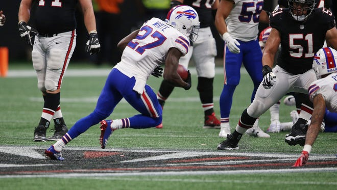 Buffalo Bills cornerback Tre'Davious White (27) picks up a fumble against the Atlanta Falcons during the second half of an NFL football game, Sunday, Oct. 1, 2017, in Atlanta. White scored a touchdown on the play. (AP Photo/John Bazemore)
