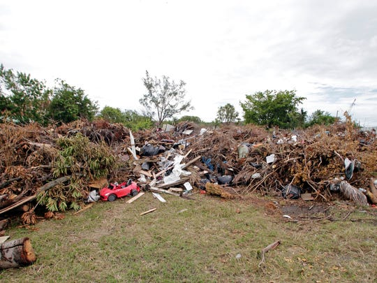 This photo shows a temporary holding area for debris caused by Hurricane Irma in Sweetwater, Fla. The Miami suburb was flooded in 1999 by a hurricane and again in 2000 by more storms. It received $2 million from FEMA for debris removal and repairs to public facilities. More than a decade later, FEMA demanded the money back, citing a lack of documentation for the costs.