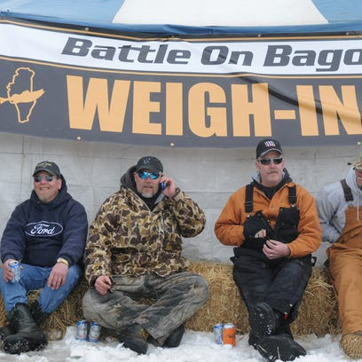 This group of ice fishermen, from left, Kevin Welch,