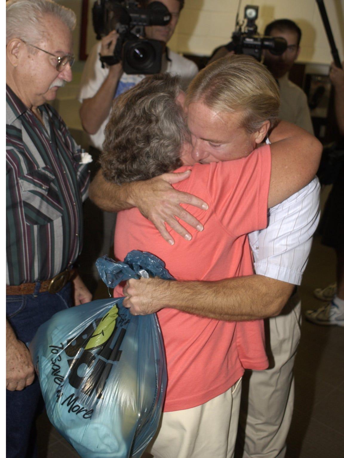 FILE: Free at last. Mary and Gary Dedge greet their