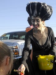 Stacy Borsini hands out candy.