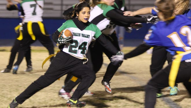 Virgin Valley's Elizabeth DeLeon looks for running room during the Lady Bulldogs' 34-0 victory over Moapa Valley on Tuesday night in Overton.