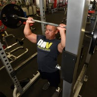 'I wasn't going to allow it to defeat me,' says disabled veteran setting new powerlifting records