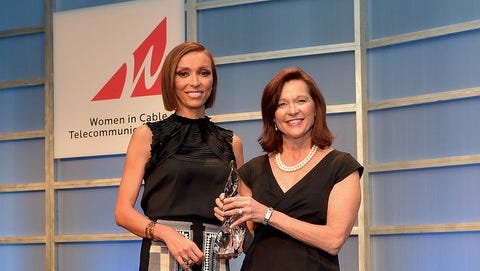 Host Giuliana Rancic (L) presents Debbie Stang of Midcontinent Communications with a PAR Excellence Award.