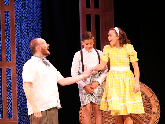"Emile (Ken Garcia) and his children (Christopher Ray and Emily Abrams) in a scene from the Plays in the Park production of ""South Pacific."""