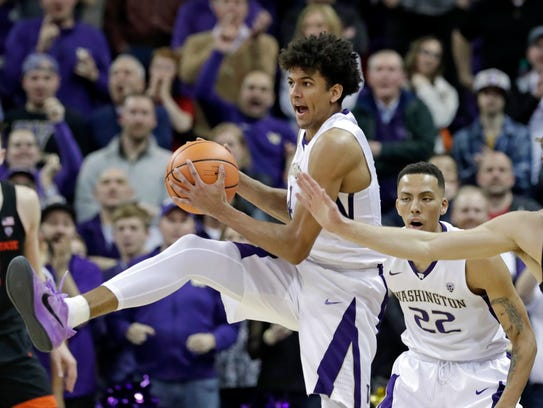 Washington's Matisse Thybulle, left, steals a pass intended for Tres Tinkle of Oregon State last week. Thybulle was named the Pac-12 Defensive Player of the Year on Monday.