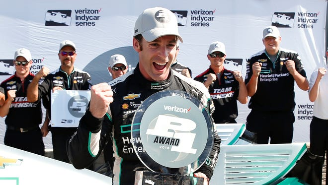 Simon Pagenaud celebrates after winning the pole position in qualifications for race one of the IndyCar Detroit Grand Prix auto racing double header on Belle Isle in Detroit, June 3, 2016.
