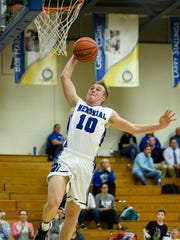 Memorial's Michael Lindauer (10) dunks the ball with