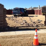 An SUV that struck a child in north Fort Worth on November 29, 2014 also knocked down a school zone sign, a tree and crashed through a brick wall.