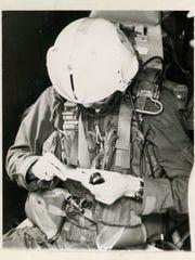 Vietnam veteran Tommy Baxter prepares for a reconnaissance mission aboard an EA3