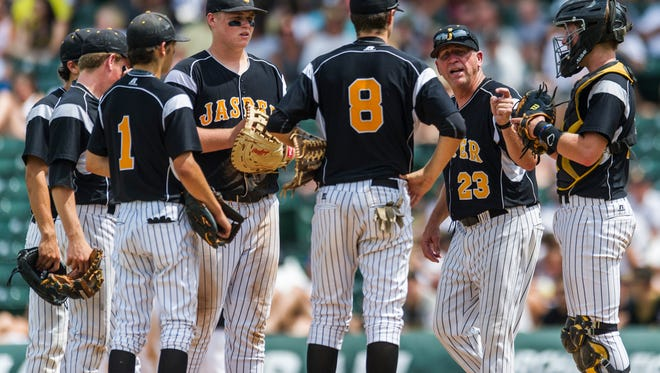Jasper Head Coach Terry Gobert talks to his team at the pitchers mound during the fourth inning of the Class 3A state championship against the South Bend St. Joseph Indians at Victory Field in Indianapolis, Ind., on Saturday, June 17, 2017. The St. Joseph Indians shut out the Jasper Wildcats, 4-0.