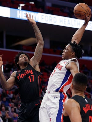 Blazers forward Ed Davis jumps to block an attempted dunk by Pistons forward Stanley Johnson during the second half Monday.