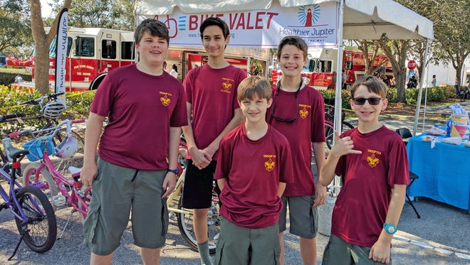 The Boy Scouts from Troop 774 were on hand to park the bikes of those event-goers who decided to take the healthier route to the recent Jupiter Jubilee.
