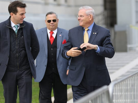 U.S. Sen. Bob Menendez smiles at his son, Robert Menendez