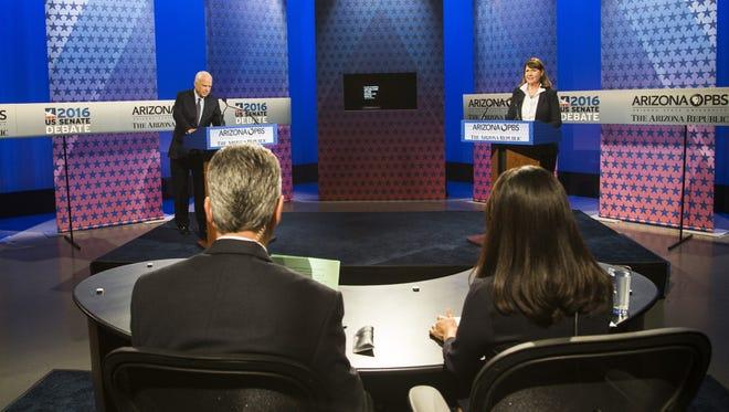 U.S. Senate candidates Rep. Ann Kirkpatrick and incumbent Sen. John McCain talk before their only debate, on Arizona PBS on Oct. 10, 2016, in Phoenix.