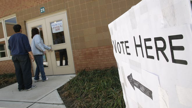 Voters walk into a school to cast a ballot on an election day in 2009. Hazlet schools is no longer having class on election days because of security concerns.