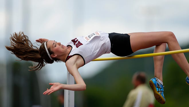De Pere's Lindsey Mirkes clears the bar as she competes in the Division 1 high jump during the WIAA state track and field meet at Veterans Memorial Field Sports Complex in La Crosse on June 4, 2016. Mirkes finished as the D1 state runner-up.