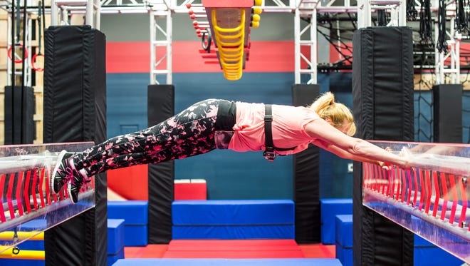 """Wendy Oberholtzer, of North Lebanon Township, tackles the spider wall as she trains for """"American Ninja Warrior"""" at Paramount Sports Complex on Tuesday, June 7, 2016."""