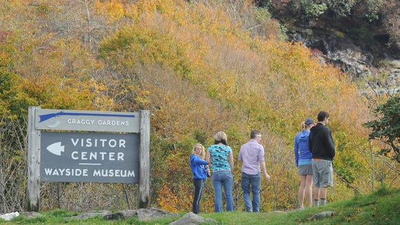 Visitors to the Blue Ridge Parkway take-in fall colors