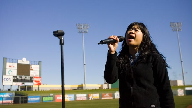 Carmela Fernandez, of Goodyear, sings the National Anthem during the 2007 Surprise Stadium Spring Training National Anthem Auditions at Surprise Stadium on Saturday.