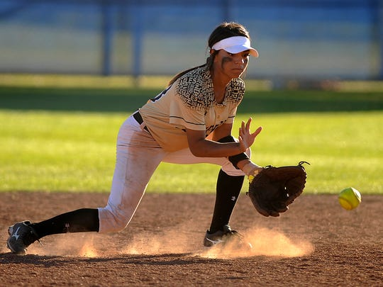 Abilene High shortstop Alyssa Washington (23) fields a ball during the bottom of the first inning of the Lady Eagles' 13-1 win in the Abilene Icebreaker softball tournament on Friday, Feb. 24, 2017, at Cooper High School.