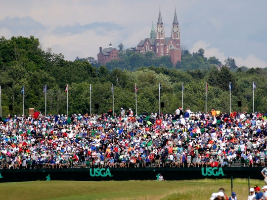 Jun 18, 2017; Hartford, WI, USA; Holy Hill oversees action during the final round of the 2017 U.S. Open Championship at Erin Hills. Mandatory Credit: Mike De Sisti/Milwaukee Journal Sentinel via USA TODAY NETWORK