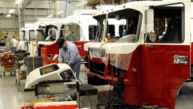 Firetruck cabs are being built at Spartan Motors in this 2010 photo. The company says it will donate $30,000 over three years to a program aimed at creating jobs in Charlotte.