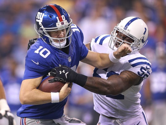 INI Colts Sider Eli Manning sacked