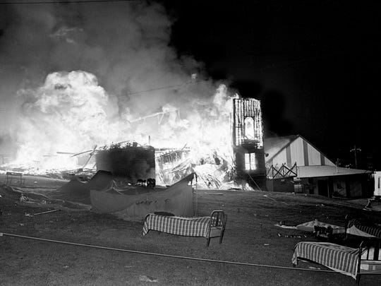 A roaring fire burns out of control as it destroys the four-building, exhibition-area complex on opening night of the 60th annual Tennessee State Fair on Sept. 20, 1965.