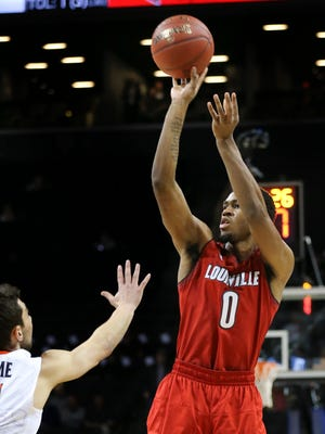 U of L's V.J. King (0) shot against the Virginia defense during the ACC Tournament in Brooklyn, NY.    Mar. 8, 2018
