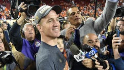 Peyton Manning leaves the game with his son Marshall.