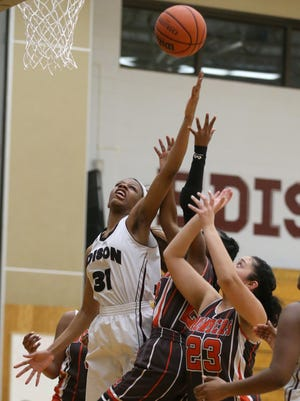 Edison's Samajah Miles, left, pulls an offensive rebound away fro a trio of East Rochester players.