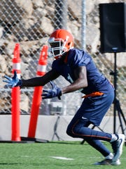 UTEP football wide receiver Tyler Batson reaches out