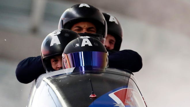 Driver Nick Cunningham, Hakeem Abdul-Saboor, Christopher Kinney and Samuel Michner of Team USA brake at the finish of a training run for the four-man bobsled competition at the 2018 Winter Olympics in Pyeongchang, South Korea on Feb. 23, 2018.