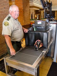 Courthouse security officer Brad Carlson works the