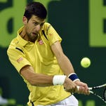Novak Djokovic of Serbia in action against Tomas Berdych of Czech Republic during their semi final match for the Qatar ATP Open tennis tournament at the Khalifa Tennis Complex in Doha, Qatar, 08 January 2016.