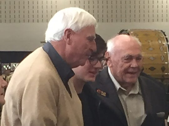 Former Indiana University basketball coach Bob Knight and ex-Purdue University coach Gene Keady have their photo taken with a fan during today's Purdue Ag Alumni Fish Fry at the Indiana State Fairgrounds.