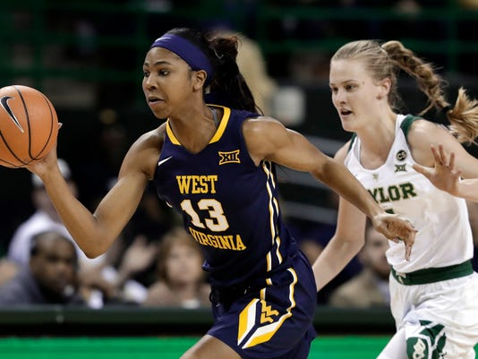 West Virginia forward Kristina King (13) comes away with a steal against Baylor guard Kristy Wallace (4) of Australia in the first half of an NCAA college basketball game Monday, Feb. 26, 2018, in Waco, Texas. (AP Photo/Tony Gutierrez)