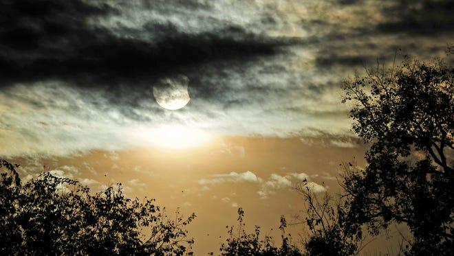 A solar eclipse appears over the TSU campus in Nashville, Tenn., Thursday, Oct. 23, 2014.