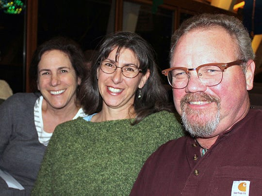 Left to right: Maggie Zlotowski, Li Lyon and Scott Lyon, all of Redding, attend the Oaksong Music Society concert with Chuck Brodsky on Jan. 28 at Pilgrim Congregational Church in Redding.