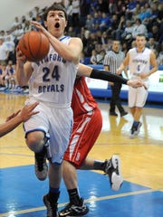 Alex Crall jumps up for a shot for Wynford during their