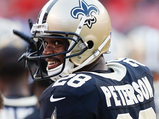 FILE - In this Aug. 10, 2017, file photo, file photo, New Orleans Saints running back Adrian Peterson stands on the sideline during warm ups before an NFL preseason football game against the Cleveland Browns, in Cleveland. The Saints open their season on Sept. 11 against Minnesota. (AP Photo/Ron Schwane, File)