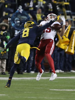 Michigan's Channing Stribling defends against Indiana's Nick Westbrook during the second half of U-M's 20-10 win Saturday in Ann Arbor.