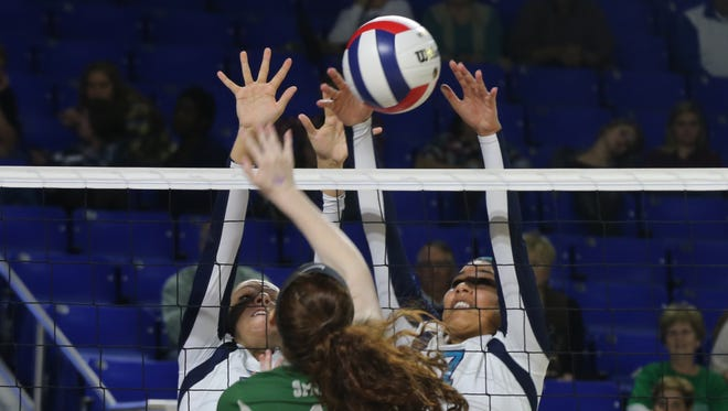 Siegel's Hannah Adams, left, and Asha Phillips blocks a ball during the TSSAA Class AAA state volleyball tournament. Siegel won 3-0.